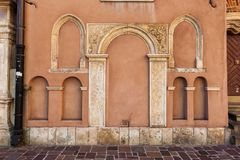 Arched Niches On Church Wall. Arched niches od different size on St Barbara's Church wall in Old Town of Krakow in Poland stock images