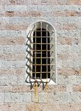 Arched old window in a stone wall Royalty Free Stock Photos