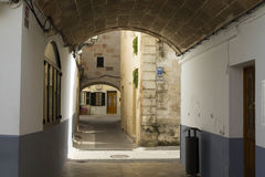 An arched pasaje in the city of Ciutadella Stock Photos