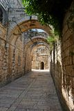 Arched passage in the Old City of Jerusalem. Shadowed arched passage in the Old City of Jerusalem Stock Images