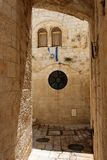 Arched passage in the Old City of Jerusalem. With Israeli flag Stock Images