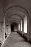 Arched passage. Perspective view of an arched passage in the ancient monastery Stock Photos