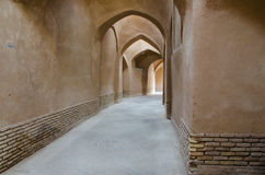 Arched passage. Passage of uncooked bricks wall with several archs Stock Photo