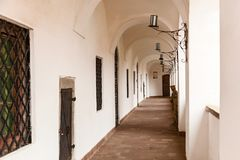 Arched passages in the old fortress. Arched passages with forged lights in the old Palanok Castle Mukacheve Stock Photos