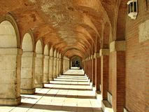 Arched passageway in Aranjuez Spain. This arched passageway with vaulted roof is located at the Palacio Real in Aranjuez Spain Stock Photo