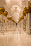 Arched path. Way with golden pillars Stock Images