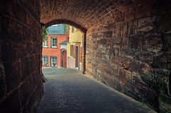 Arched pedestrian tunnel in small European city Stock Photo