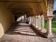 Arched porch with white stone columns in the courtyard of a Bene. Porch with white stone columns in the courtyard of a Benedictine abbey Stock Photography