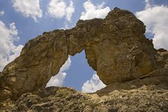 Arched rock near deserted village of Aragon, in the Pyrenees Mountains, Province of Huesca, Spain Stock Images