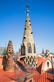The arched roof and complex chimney. The mosaic chimneys on roof of Palau G�ell , one of the earlest Gaudi's  masterpieces, restored last 25 years finished Stock Photo