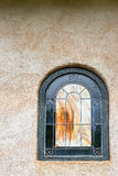Arched stained glass window Stock Photography