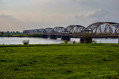 Arched, steel road bridge over the River Vistula in Grudziadz Royalty Free Stock Photo