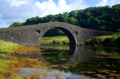 Arched stone bridge Stock Photos