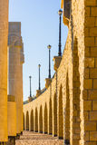 The arched stone colonnade with lanterns Stock Photos