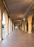 The arched stone colonnade Royalty Free Stock Image