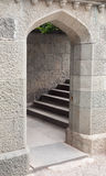 Arched stone doorway and staircase Stock Image