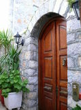 Arched stone entry with arched wooden door Stock Image