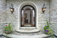 Arched stone entry to luxury home Royalty Free Stock Photography