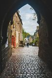 Stone gateway in Dinan. Arched stone gateway in the old town in medieval Dinan, Brittany, France Stock Images