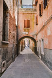 Arched street in the town of Chioggia, Italy Royalty Free Stock Image