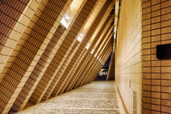 Arched tunnel contiguous to a wall of the building of Hong Kong Royalty Free Stock Photography