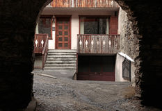 Arched view of old house with wooden balcony,Bormio, Italy Royalty Free Stock Images