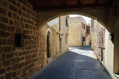 Arched view of a street with traditional architecture of the old town of Rhodes. stock image