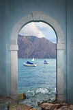 Arched vintage door, view to lake and mountains Stock Photos
