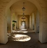 Arched walkway. An arched walkway with light shining through royalty free stock photo