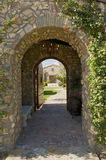 Arched Walkway With Open Door Stock Images