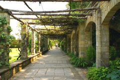 Arched way, garden, Hever castle, Kent, England Royalty Free Stock Images