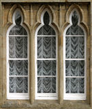 Arched Window. 3 section Trefoil or Cusped arched box sash window with stone outer stock image