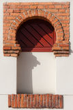 Arched window. Facade detail, arched window made of brick and wood Royalty Free Stock Photo