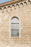 Arched window in the ancient stone wall Royalty Free Stock Image