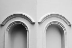 Arched of window at antique building. Monochrome background royalty free stock images