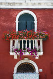 Arched Window with Balcony and Flowers Royalty Free Stock Photography