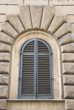 Arched window closed shutters, Italy. Royalty Free Stock Photos
