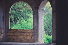 Arched big window and door in unfinished house of limestone stock photo