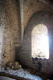 Arched Window Inside a Castle. A medieval arched stone window in a castle seen from the inside. Vertical shot Royalty Free Stock Photography