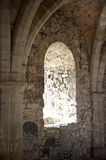 Arched Window Inside a Castle. A medieval arched stone window in a castle seen from the inside. Vertical shot Stock Photo