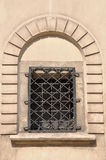 Arched window with iron grid Stock Photography