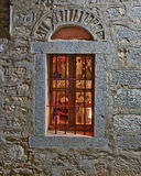 Arched window lit Royalty Free Stock Image