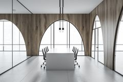 Arched window meeting room interior, white table. Modern office meeting room interior with a concrete floor, arched wooden walls and panoramic windows. White Royalty Free Stock Image
