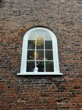 Arched window in old brick wall Royalty Free Stock Photo