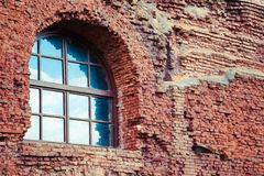 Arched window in a old red brick wall Royalty Free Stock Image