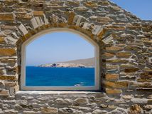 Arched window overlooking the sea. Royalty Free Stock Photography