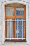 Arched window in  wall. Wooden windows with metal lattice Royalty Free Stock Photo