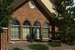 Arched Windows. Four attractive arched windows in a row on side of building royalty free stock photo