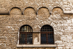 Arched Windows in Ancient House in Pula Stock Image