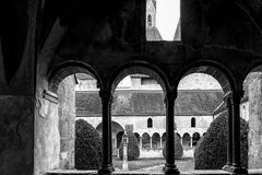 Arched windows of cathedral cloister. Stock Photo